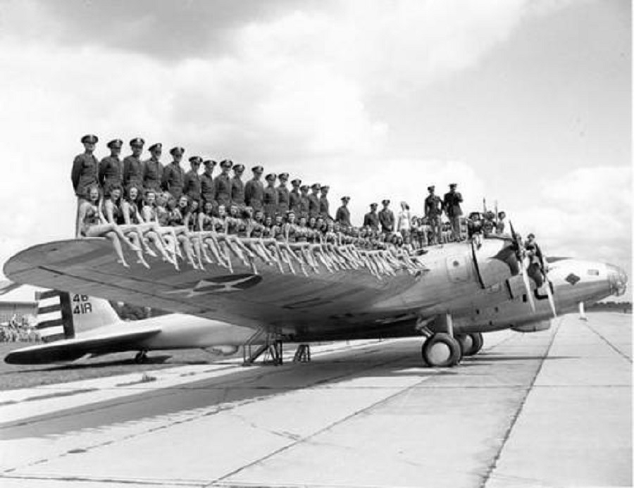 c. 1940s- Girls on the wing of a Boeing XB-15
